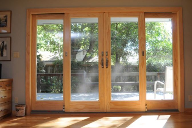 Andersen 4 Panel Frenchwood Gliding Patio Door   Hallu0027s Window Center.  Sliding ...