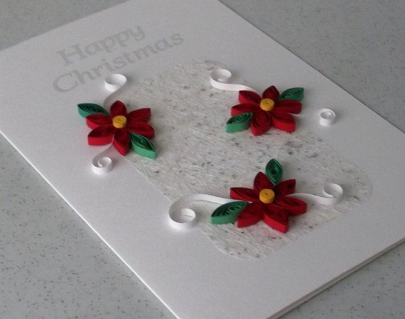 Quilled Christmas card, handmade, paper quilling    A beautiful quilled Christmas card with a message in silver foil reading Happy Christmas. Three quilling flowers adorn a panel of sparkly handmade paper, making this card extra special. An original, distinctive handmade greetings card to celebrate a the holiday season.    This pretty quilled Christmas card is sure to be appreciated by the recipient. All the quilling is handmade. I handroll each petal, leaf and shape from strips of coloured…