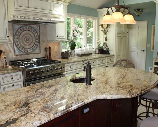 like this color scheme - wall color, granite color, cabinet color . . .yellow river granite countertop