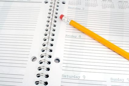 Choose a planner that has a busienss card insert so you can give them out at any time.