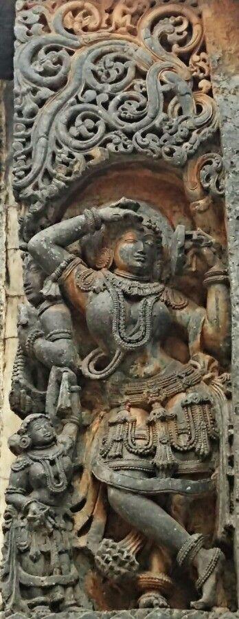 """Apsara Adorning Herself."" Halebidu Temple.  Hoysala Dynasty.  13th Century CE. Karnataka, India."