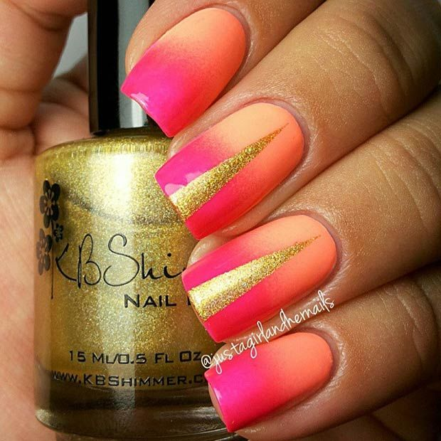 Check out these gorgeous hot pink and orange ombre nails that have golden slits in them! You could totally rock these fabulous nails on a hot summer day at the pool.