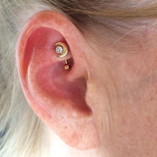 Rook piercing by Courtney Jane Maxwell of Saint Sabrinas. Jewelry by Anatometal.