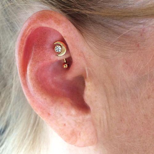 Rook piercing by Courtney Jane Maxwell of Saint Sabrinas. Jewelry by Anatometal.