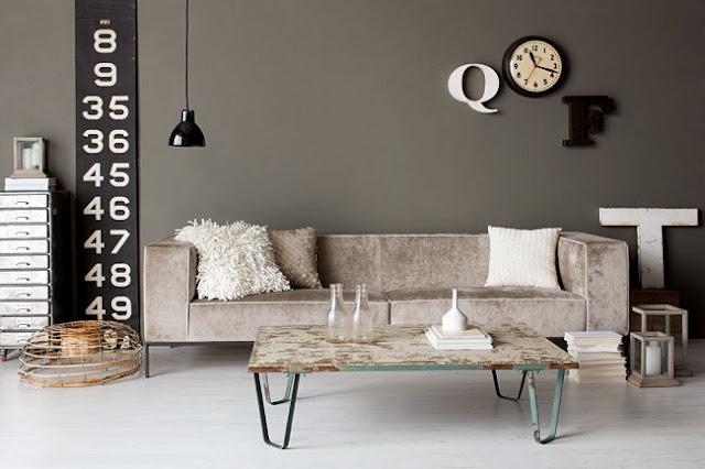 Dark grey walls work with a light floor