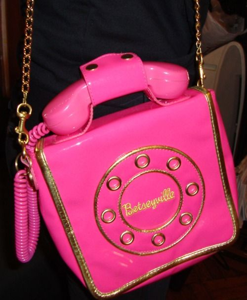 Betsey Johnson. I wish the phone on this bag actually connected to ur cell phone, that would be awesome!!!!