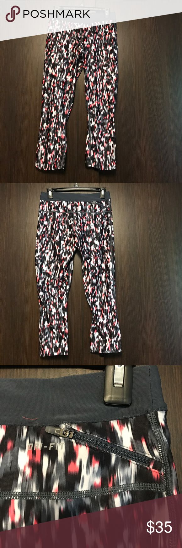 """Nike Capri Multicolored Nike Capri. Never worn. No flaws. Draw strong, """"just do it"""" on backside of band. Small zipper pocket in back. No trades. Nike Pants Capris"""