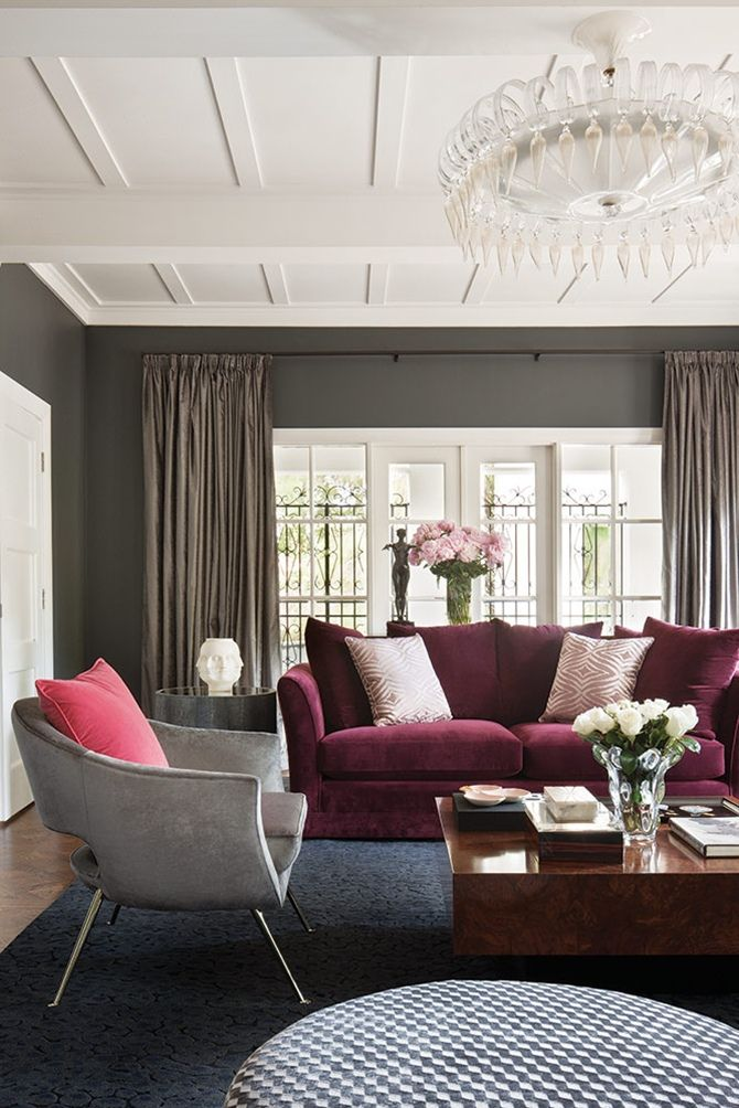 This living room ambience is a stunning combo of burgundy and gray velvets. The 2 seat sofa and the armchairs are a contemporary version