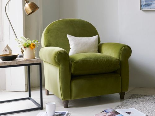 Handmade in Britain, the Club is a classic occasional armchair with gorgeous curves. Seen here in Olive push velvet, available in upholstered fabrics or walnut leather. Place this comfy number in the bedroom or sitting room.