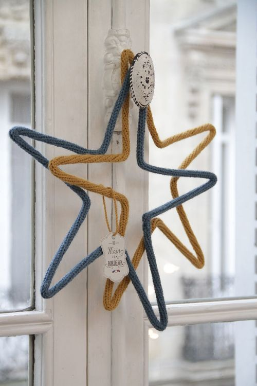 Stars in ochre and blue - could I sew old sweaters, or would these have to be knit?  stuff with bent clothes hangers?  Different colors for sure, although these are pretty in an unusual way, just not very Christmassy.