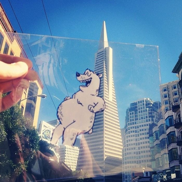 marty cooper doodles cartoons on transparency sheets and places into the real world