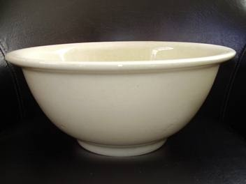 """Large Crown Lynn Mixing Bowl. """"Hand-thrown"""" and """"lathe-finished"""" WHITEWARE produced by ERNIE SHUFFLEBOTTOM in the style of KEITH MURRAY from Wedgwood 1948-1950's. Base stamped with TIKI motif & 3 STARS & reads CROWN LYNN NEW ZEALAND. Bowl measures 31.5cm diameter X 16cm depth."""