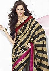 Welcome to the new era of Indian fashion wear. This dark fawn and black faux crepe saree is nicely designed with geometric print and patch bordered work. This saree gives you a modern and different look in fabulous style. Matching blouse is available. Slight color variations are possible due to differing screen and photograph resolution.