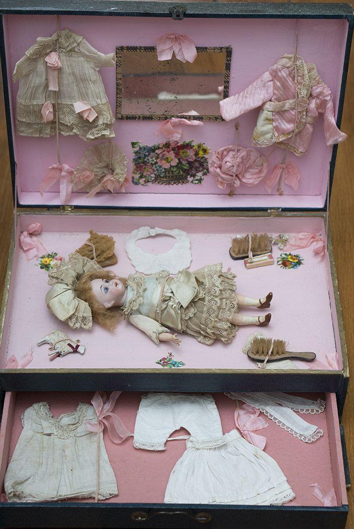 Antique German All Original Tiny Doll in presentation box w/trousseau Antique dolls at Respectfulbear.com