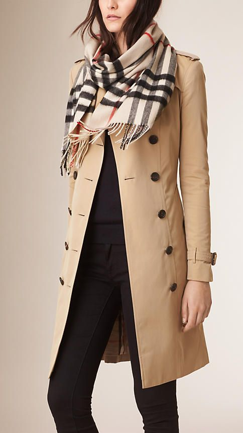 Burberry pairs their cashmere scarf in Heritage with the classic Honey Trench Coat.