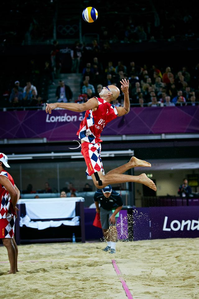 "London 2012 - At 6'9"" Phil Dalhausser of the USA coils to release an explosive jump serve."