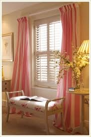 Add curtains with plantation shutters -- for bedroom sitting area..different color, of course!