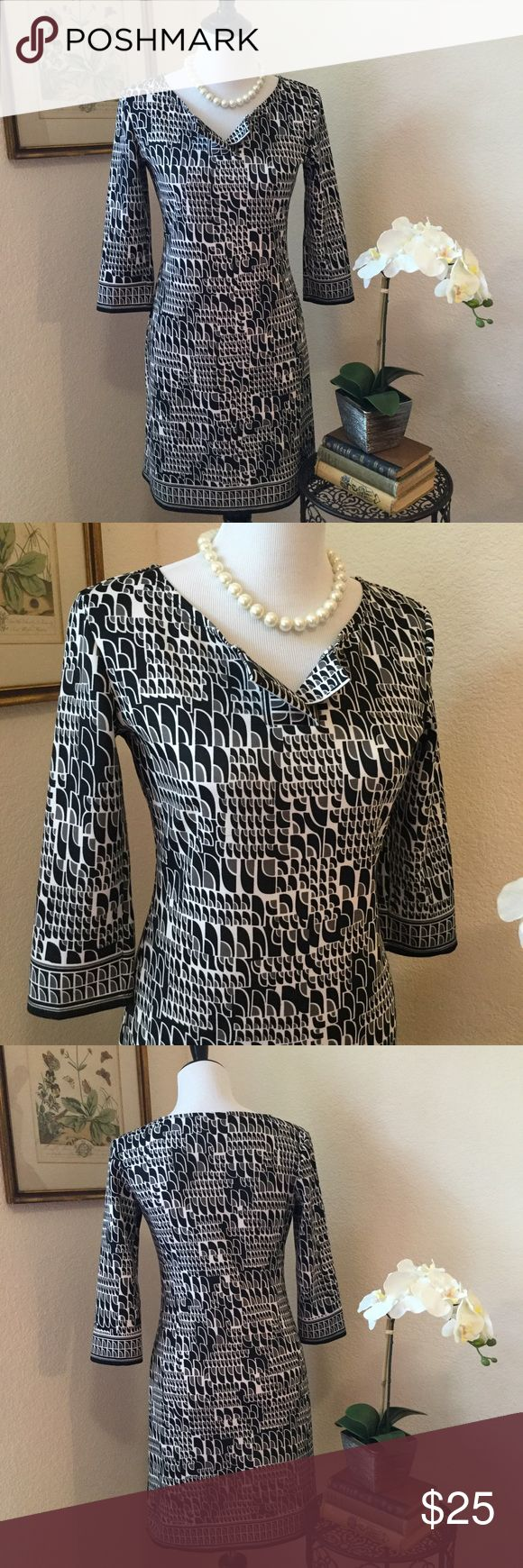 MAX STUDIO Geometric Print Shift Dress Cool black and white unlined shift dress in a mod graphic print. This slip-on dress has 3/4 length sleeves and a straight body. Wear for career or for a special event. In excellent like new condition. Poly and spandex blend. Easy to wear! Max Studio Dresses