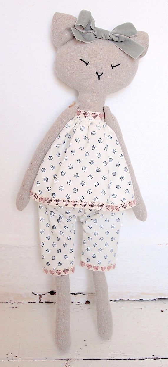 Piccola Lucia is 51 cm (approx 20 inches) from head to toes. Her camisole and pats are (gently) removable. He arms are jointed with little wooden heart-shaped buttons and she can stretch them up and down or side to side. She can be balanced to stand or sit. She can be spot-cleaned. Due