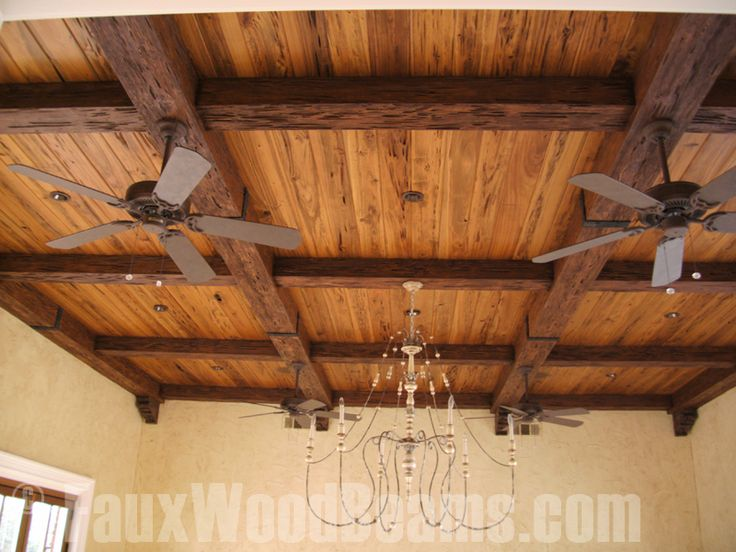 Faux pecky cypress creates a distinctive looking ceiling for Fake wood beams for ceiling