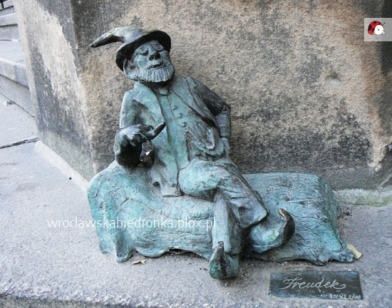 """""""little Freud"""" the Gnome, sits back on his psychiatrists couch."""