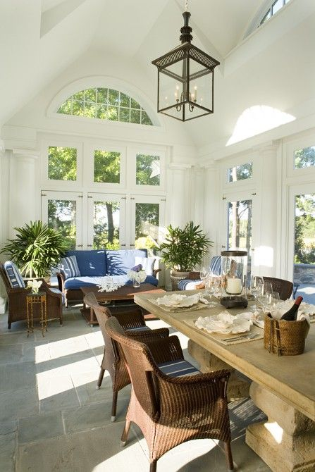 Sunroom With Flagstone Floor And Vaulted Ceiling