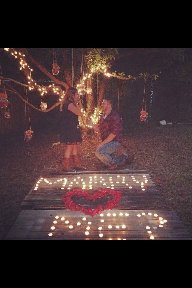 DIY proposal: crystal jars, twine, floating candles, tea light candles, Christmas lights, sunflowers and roses. And love, can't forget the love!