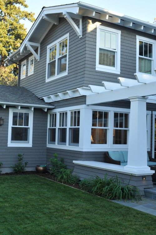 nice pergola.  An attempt at Craftsman detailing, with tapered column and exposed rafter tails.  could use a lot more trim, everywhere.