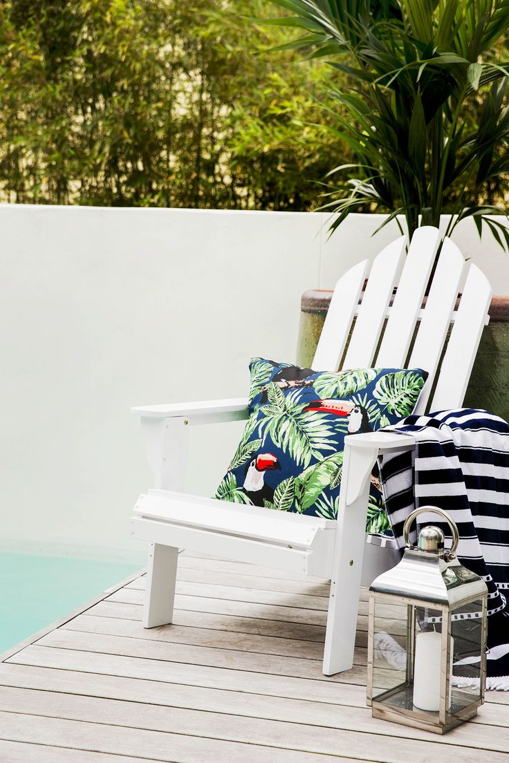 Nothing quite says vacation like this 'Adirondack' chair, colourful 'Panama Toucan' outdoor cushion, 'Ravello' beach towel and scene-setting 'Square Base' lantern in Silver.