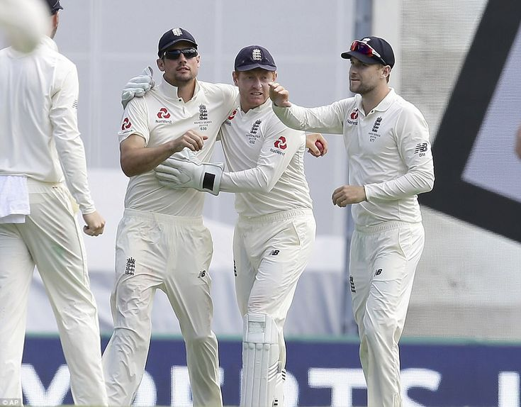 Alastair Cook, Jonny Bairstow and Dawid Malan celebrate after taking the wicket of Australia's Pat Cummins for 42 runs