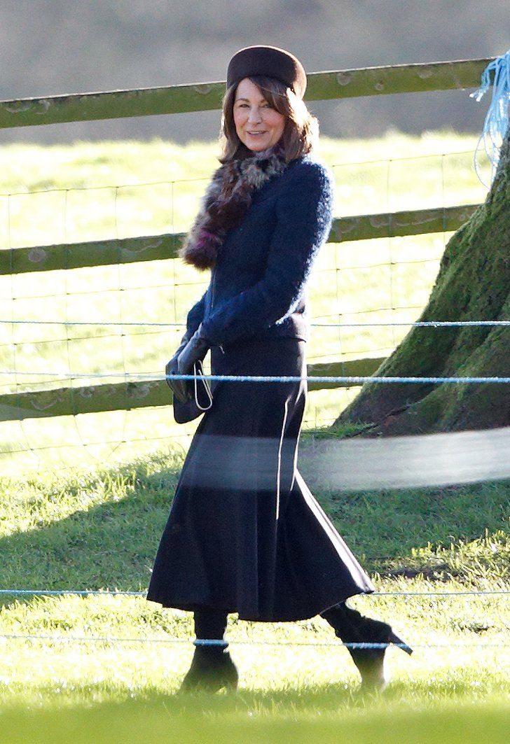 Pin for Later: Kate Middleton's Mom Just Stole Her Style Spotlight But It Was Her Mom, Carole Middleton, That Really Stood Out to Us Just look at her furry scarf! She's also a fan of boots.