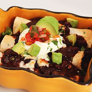 Black Beans with Mexican Enchilada  SERVES: 4-5 servings     INGREDIENTS     17.3 oz. Imagine® Savory Black Bean Soup  1 avocado, diced small  1 lime  3 medium flour tortillas  1 C. pre-cooked brown or white rice  2 oz. crumbled queso fresco cheese, drained and grated  1 C. salsa  1/2 C. sour cream  1/4 C. cilantro, roughly chopped     COOKING DIRECTIONS     STEP 1: In a small pot, heat the soup, then reserve on side. Cut the lime in half lengthwise. Squeeze the juice of half a lime over the…