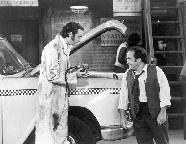 Andy Kaufman as Latka Gravis and Danny DeVito as Louie DePalma in a scene from…     Be nice to Louie, Latka...you wouldn't believe me if I told you, but be nice.