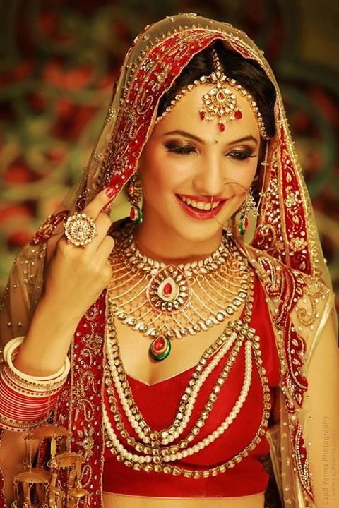 Indian bride wearing bridal lehenga and jewelry. #IndianBridalHairstyle #IndianBridalMakeup