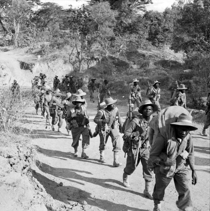 Troops of the 11th East Africa Infantry Division on the road to Kalewa, Burma, during the Chindwin River crossing. The 11th East Africa Infantry Division was composed of soldiers from the modern-day nations of Kenya, Uganda, Malawi, Tanzania and...