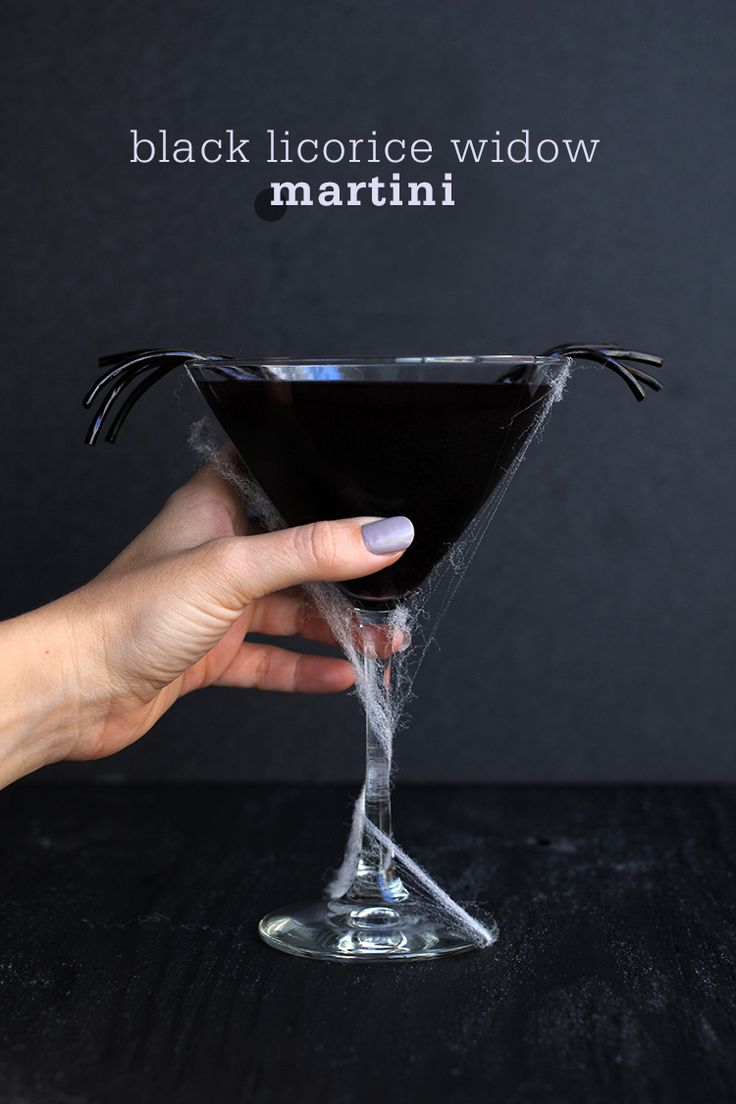 Black Licorice Widow Martini - Black Vodka, Jägermeiste, Blueberry Pomegranate Juice, Black Licorice Rope for Garnish.