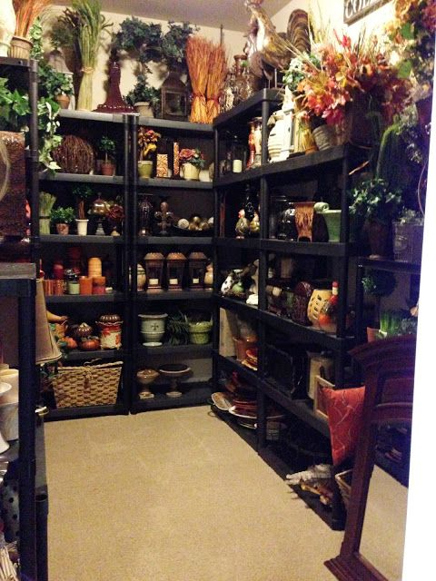 This is the Home Decor/Storage Room.  She says. (every girl needs one of these).  (And I agree!! lol I have got to make me one of these!!) She says she loves this space, because home decorating is easy when you know where everything is and everything has it's own place. This is where all the magic happens.  Tuscan inspired home tour in the Pacific Northwest