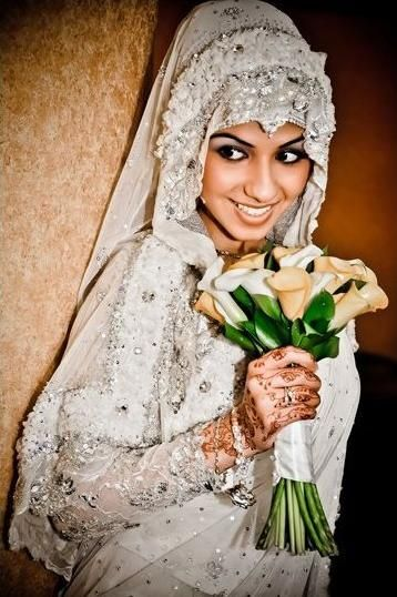 Gorgeous, but too much flowers on the head would have been fabulous without it. Nice work on the sleeve it's a great modern touch to a bridal outfit.