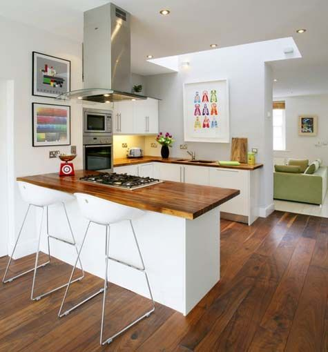 This shape of kitchen at the back of the room would work well. Kitchen table could be in front of the breakfast bar area
