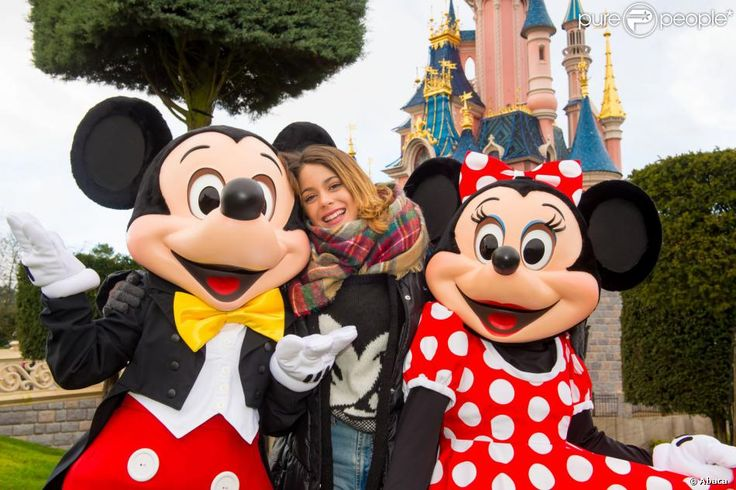 Martina Stoessel and the Violetta cast pose with Mickey and Minnie Mouse during their trip to Disneyland Paris on Thursday afternoon (January 16) in France. Description from justjaredjr.com. I searched for this on bing.com/images