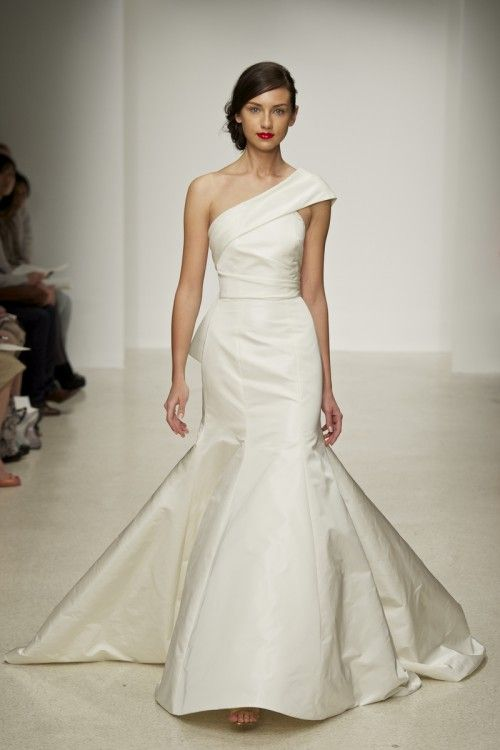Silk radzimir fit to flare one shoulder gown with exaggerated back bow. Available in Ivory or White.