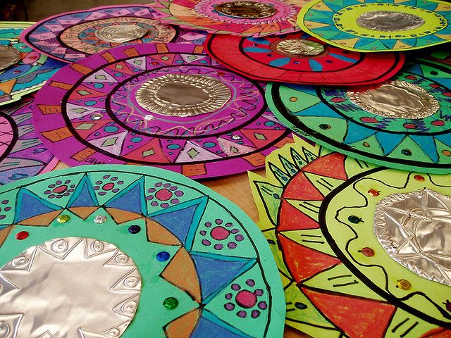 Mexican Mirrors- metal tooling.  Maybe paper plates for coloring with hole cut out, & thick aluminum foil.  Could even make garland by stringing together, add a string of lights for extra flare.
