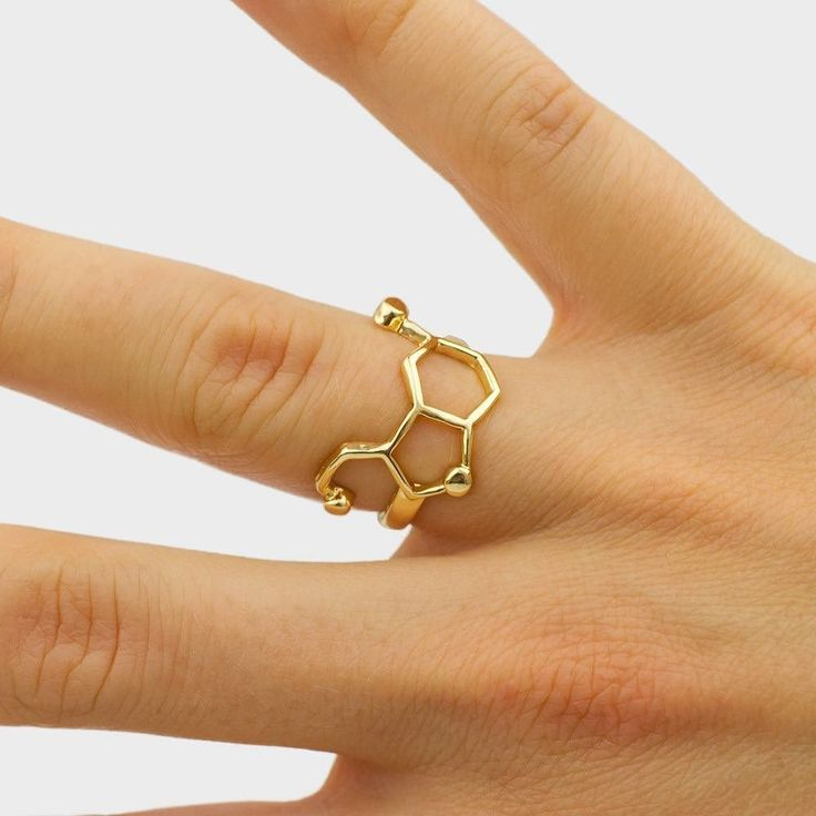 Our serotonin (happiness) molecule ring. Get it at moleculestore.com  #molecule #chemistry#chemist #science #scientist #molecules #orgchem #chemical #staynerdy #lookattheblue #moleculering #serotonin #happiness #neurotransmitter