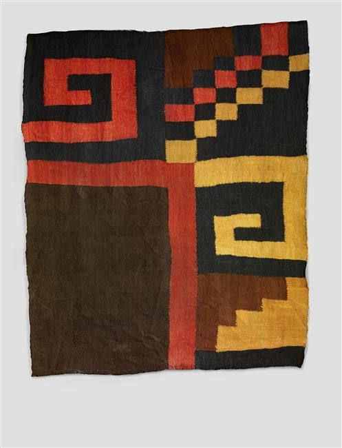 """Peru   Manto (?) (Fragment)   In the Nazca culture, textiles are often decorated with geometric patterns and large shades of red, yellow and black, executed according to the difficult technique of discontinuous warp and weft. This fragment may have come from a """"manto"""", a large rectangular room used textile shroud .. 200-600 AD. Quai Branly Museum"""