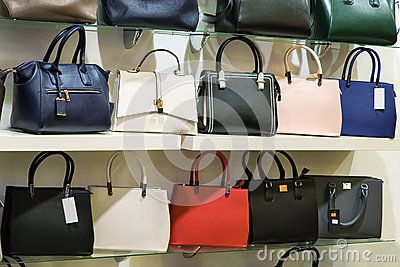 The storefront presents for sale a variety of models of women's handbags.