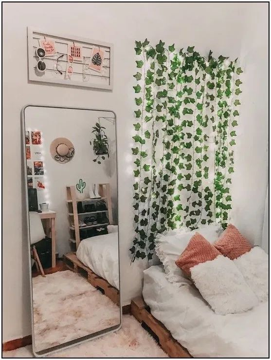 I love the mirror and the DIY vine headboard! Great way to ...