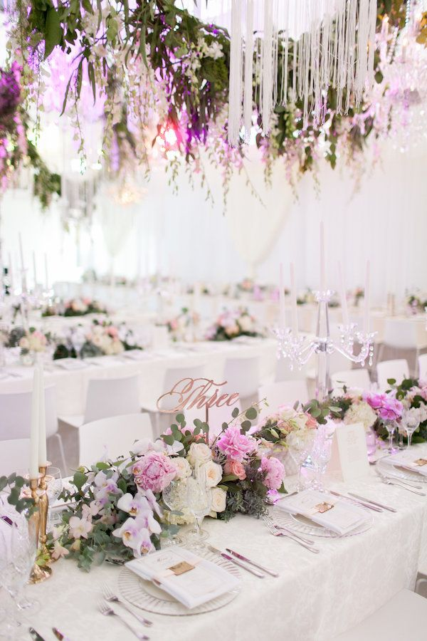 Gorgeous Cape Town Wedding at Cavalli Wine Estate featuring gorgeous white decor and lush hanging greenery, and a bride in a tiara.