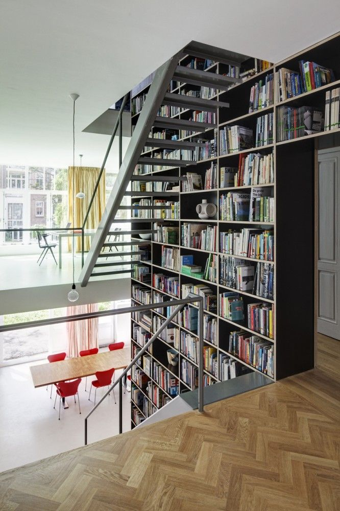 Vertical Loft / Shift Architecture Urbanism (might be my future home, as I need this amount of shelf space)