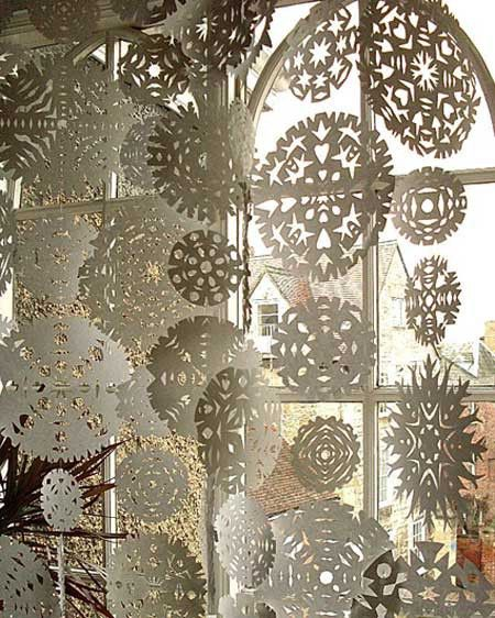Snowflake Curtain - Paper snowflakes, sewn together in strands. Bunch up or space out as you like.