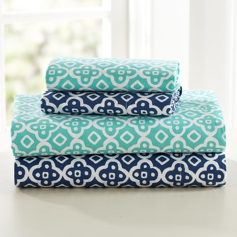 maybe sheets with a pattern like this (i like the dark blue) to go with a green duvet cover?